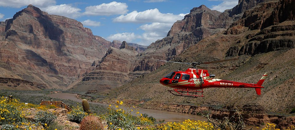 A state-of-the-art helicopter lands on the Grand Canyon floor.