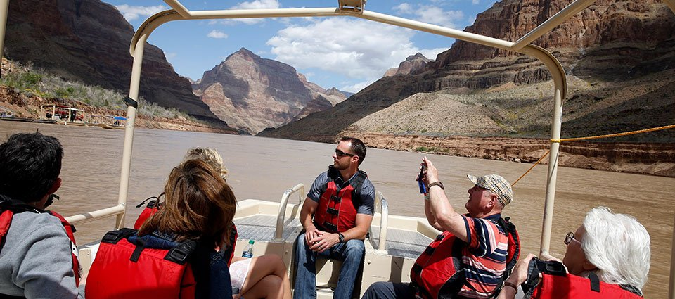 A pontoon boat tour between the walls of the Grand Canyon West.