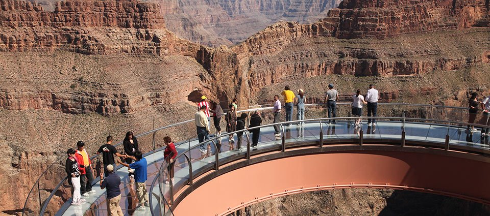 Guests sightseeing atop the Skywalk glass bridge.