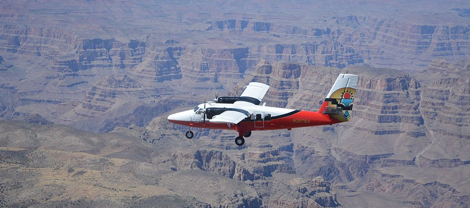 A West Rim airplane tour soars across the canyon expanse.