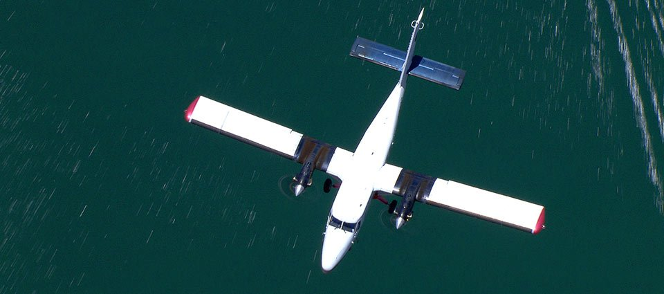 An airplane tour soars over Lake Powell's sparkling waters.