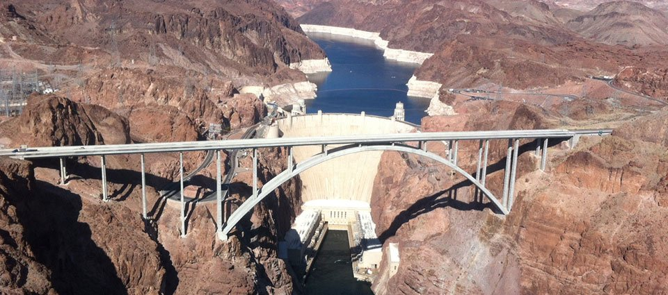 The Hoover Dam amidst the desert scenery.