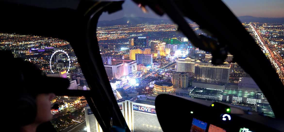 An aerial view of the Las Vegas Strip through the window of a helicopter