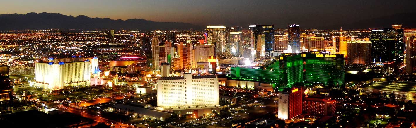 A panoramic view of the Las Vegas Strip casinos at night.
