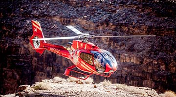 Helicopter landing on the bottom of the canyon