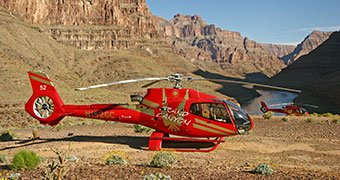 A Papillon Grand Canyon Helicopters landing in the Grand Canyon during the Grand Celebration tour