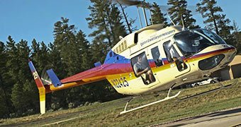 A Grand Canyon helicopter tour lands at the national park.