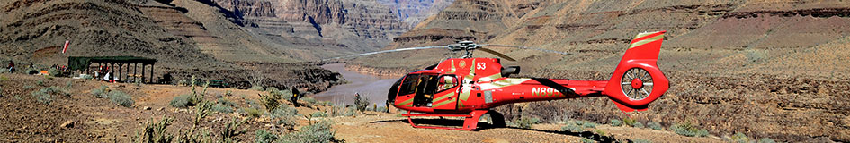 A Papillon helicopter flying over the Grand Canyon as passengers enjoy the discounted Grand Celebration helicopter tour
