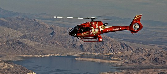 Red EC-130 flying over Lake Mead