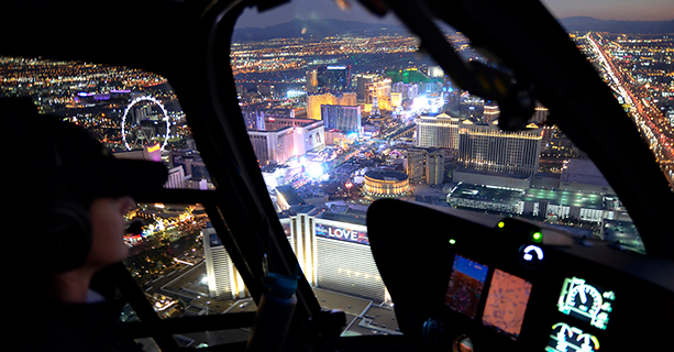 A pilot navigates a helicopter over the Las Vegas Strip.