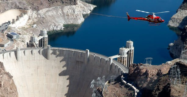 A helicopter tour in flight over Hoover Dam.