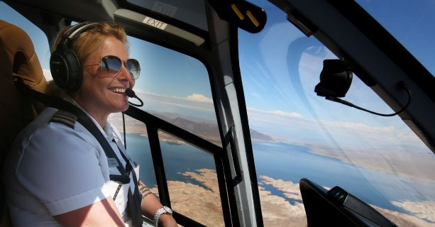 Female helicopter pilot midflight.'