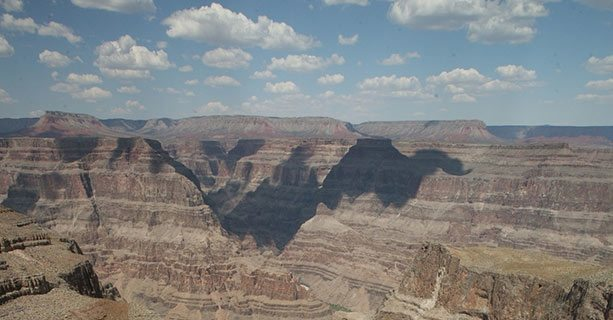 Areial view of the West Rim of the Grand Canyon on a sunny day.