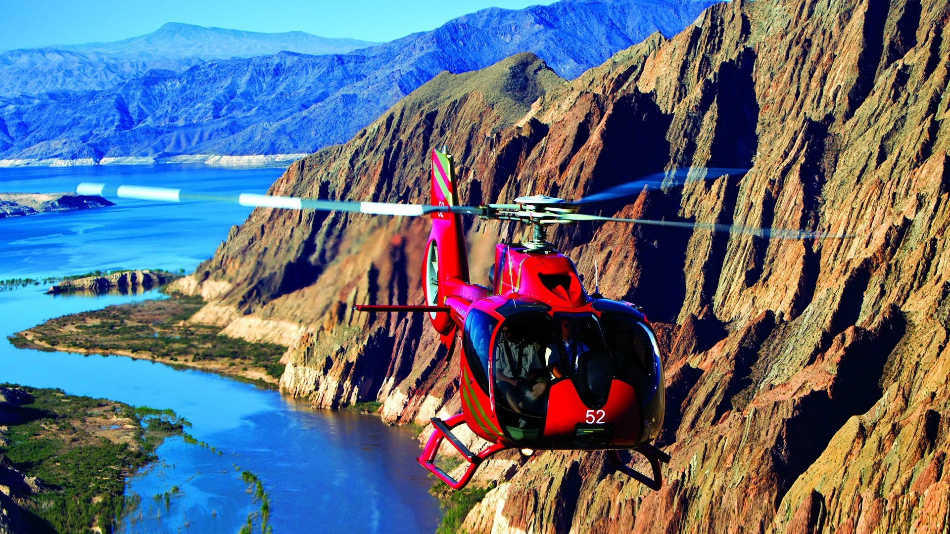 EC-130 helicopter with passengers flying over Lake Mead