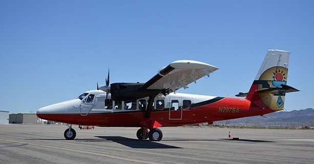 A Twin Otter airplane parked on a tarmac.