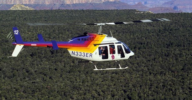A Grand Canyon helicopter tour flies over the Kaibab National Forest.