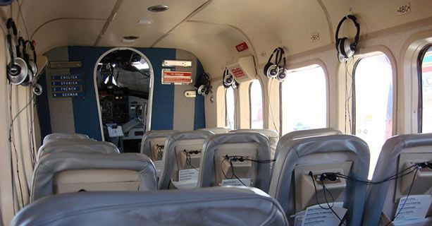 The interior cabin of a Twin Otter aircraft.
