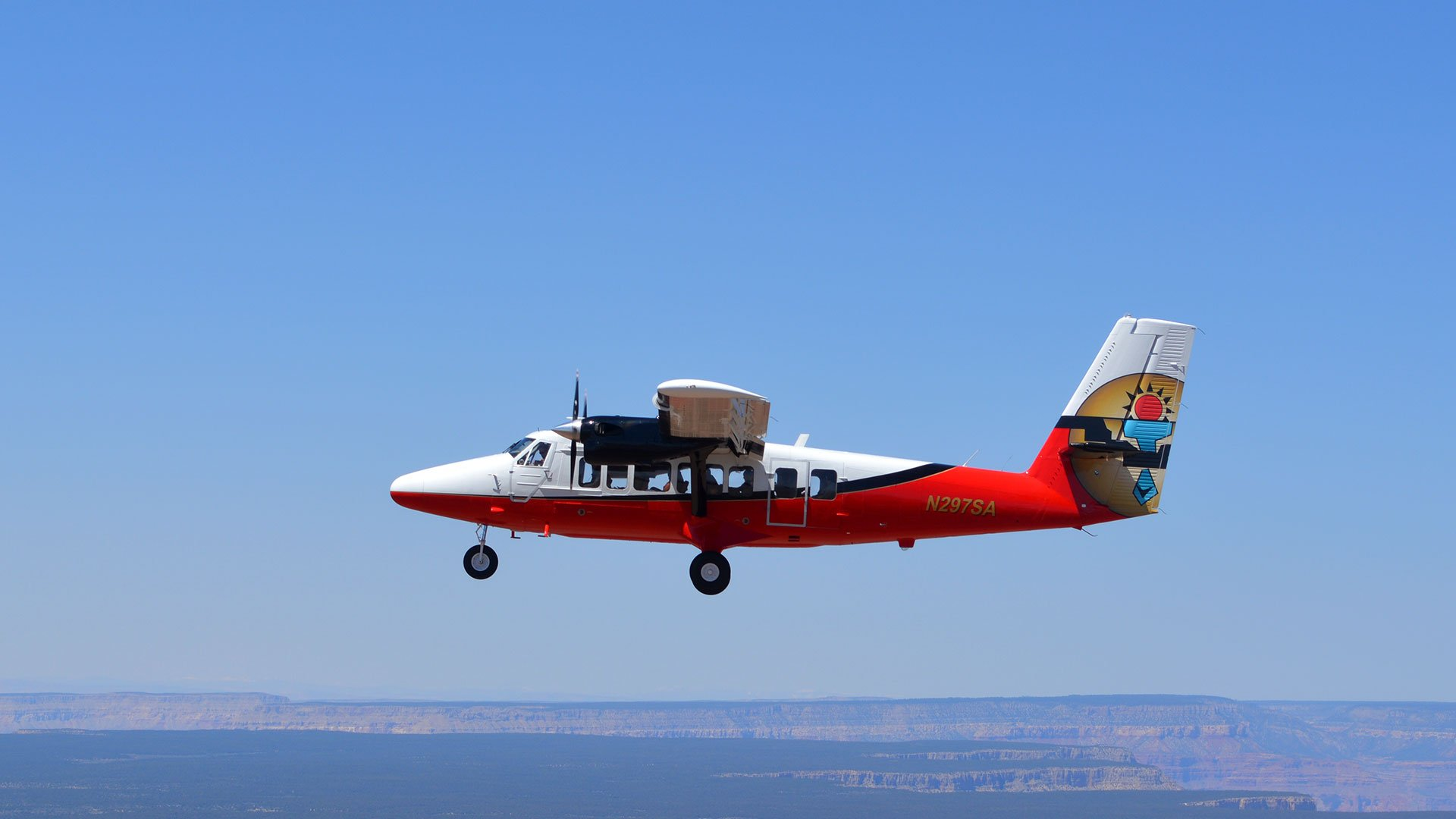 A Twin Otter plane in flight