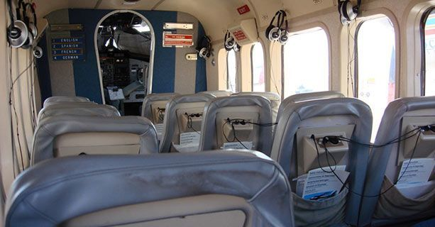 The interior cabin of a Twin Otter airplane.