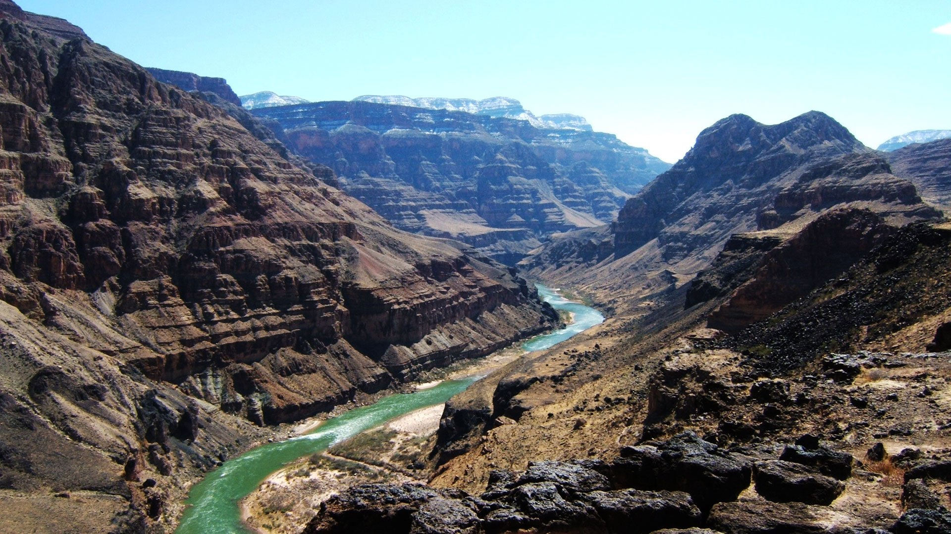 A rugged region of the Grand Canyon with the Colorado River cutting through.