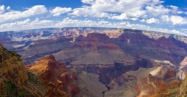 A view of the Grand Canyon South Rim with a bright sky above it.