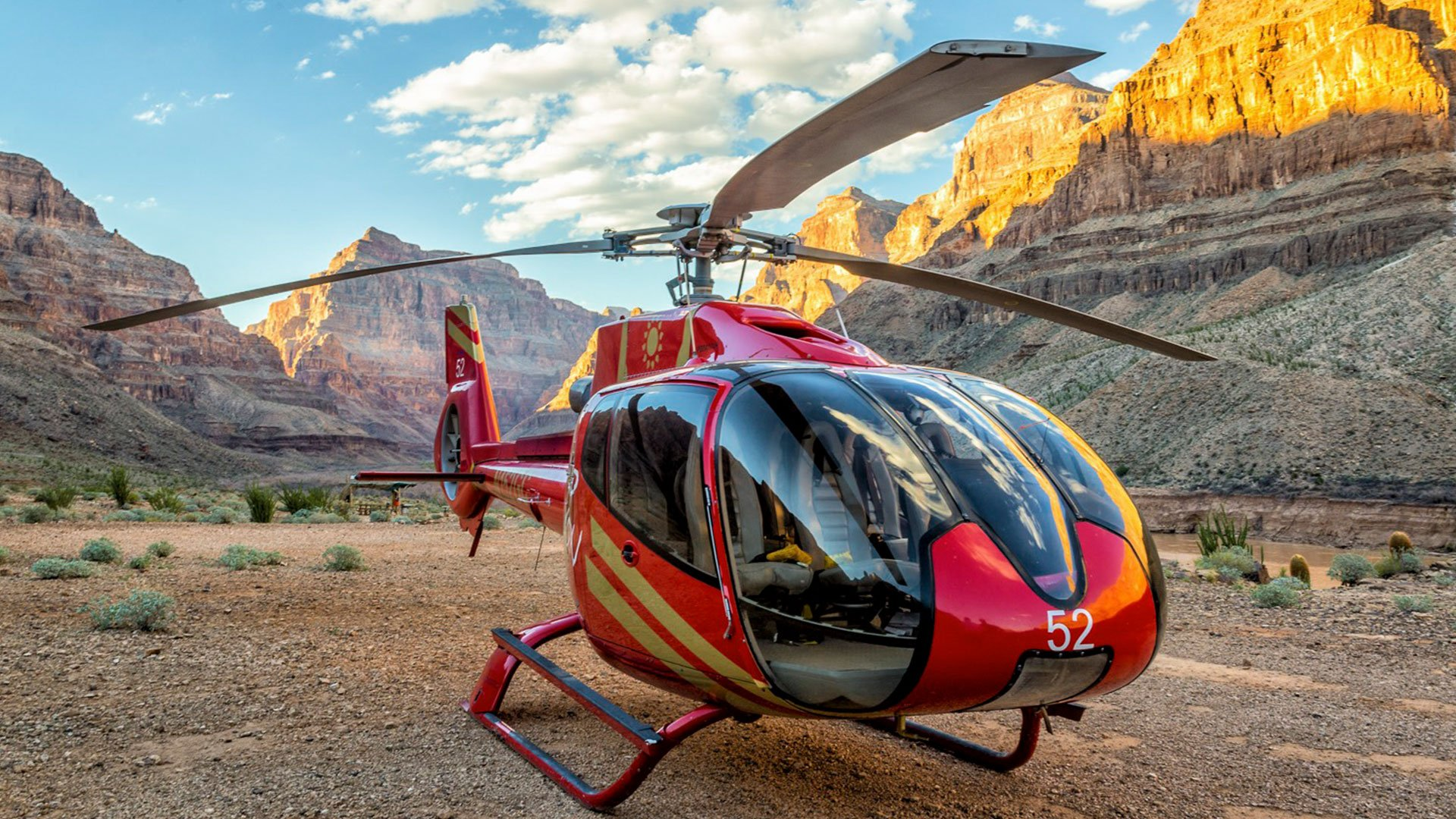 Red EC-130 helicopter landed at the bottom of Grand Canyon West Rim
