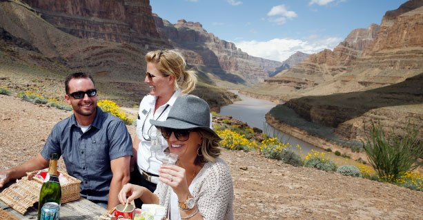 Guests enjoy a champagne picnic on the bottom of the Grand Canyon.