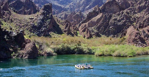 Guests on a raft exploring the banks of the Colorado River.