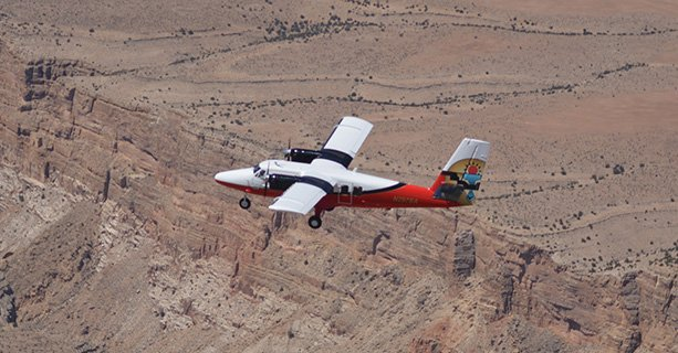 A Grand Canyon airplane tour soars over the desert landscape.'
