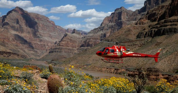 A helicopter descends to the bottom of the Grand Canyon West Rim.