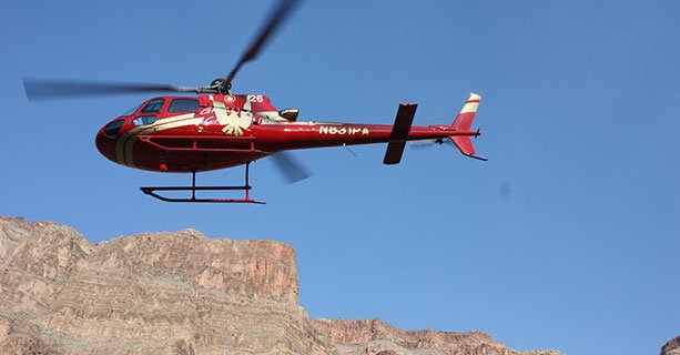 A helicopter takes to the sky at the Grand Canyon.