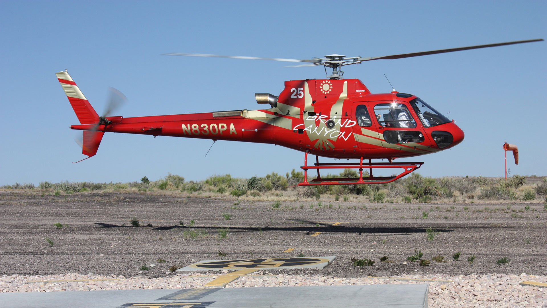A Bell helicopter sets off on a tour.