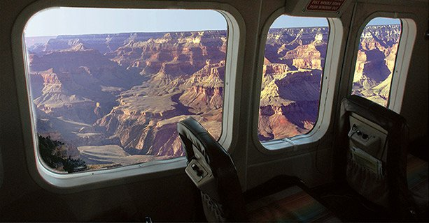 An aerial view of the Grand Canyon seen from the window of an airplane.