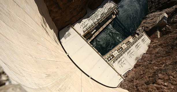 The bottom of Hoover Dam and the Colorado River seen from above.