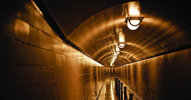 A dimly-lit hallway within the Hoover Dam's interior.