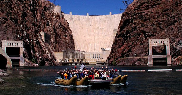 Guests on a Raft on the Colorado River in front of the Hoover Dam