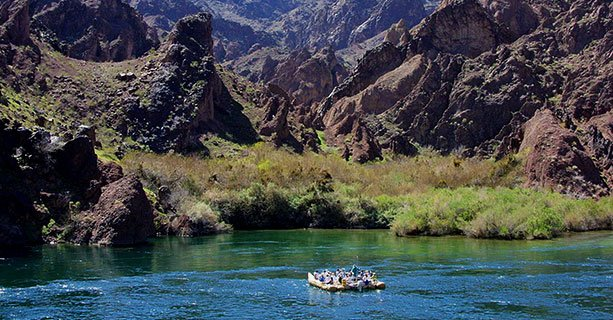 Guests Exploring the Colorado River in a raft'
