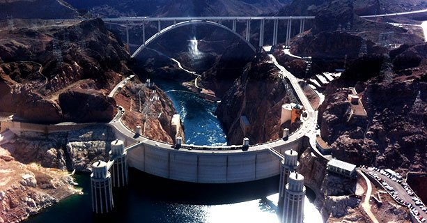 The Hoover Dam as seen from behind with the O'Callaghan-Tillman Memorial Bridge behind it.