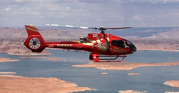 A helicopter soars above Lake Powell.