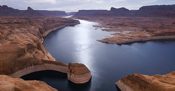 A view of Lake Powell and the surrounding desert scenery from the sky.