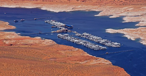 A marina located within Lake Powell, seen from a helicopter.
