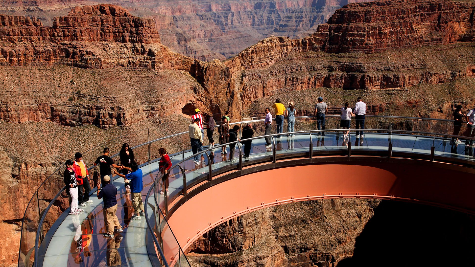 Guests on the Skywalk glass bridge enjoying the view of the Grand Canyon