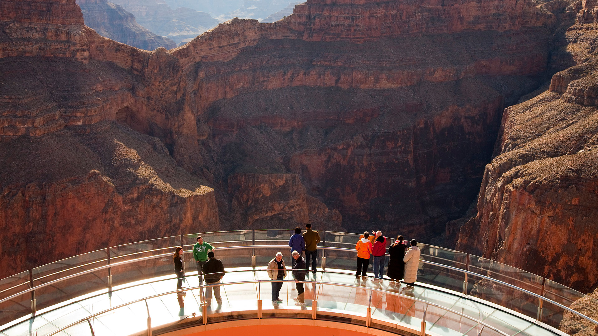 Guests looking through the glass floor of the Skywalk Bridge at the Grand Canyon West.