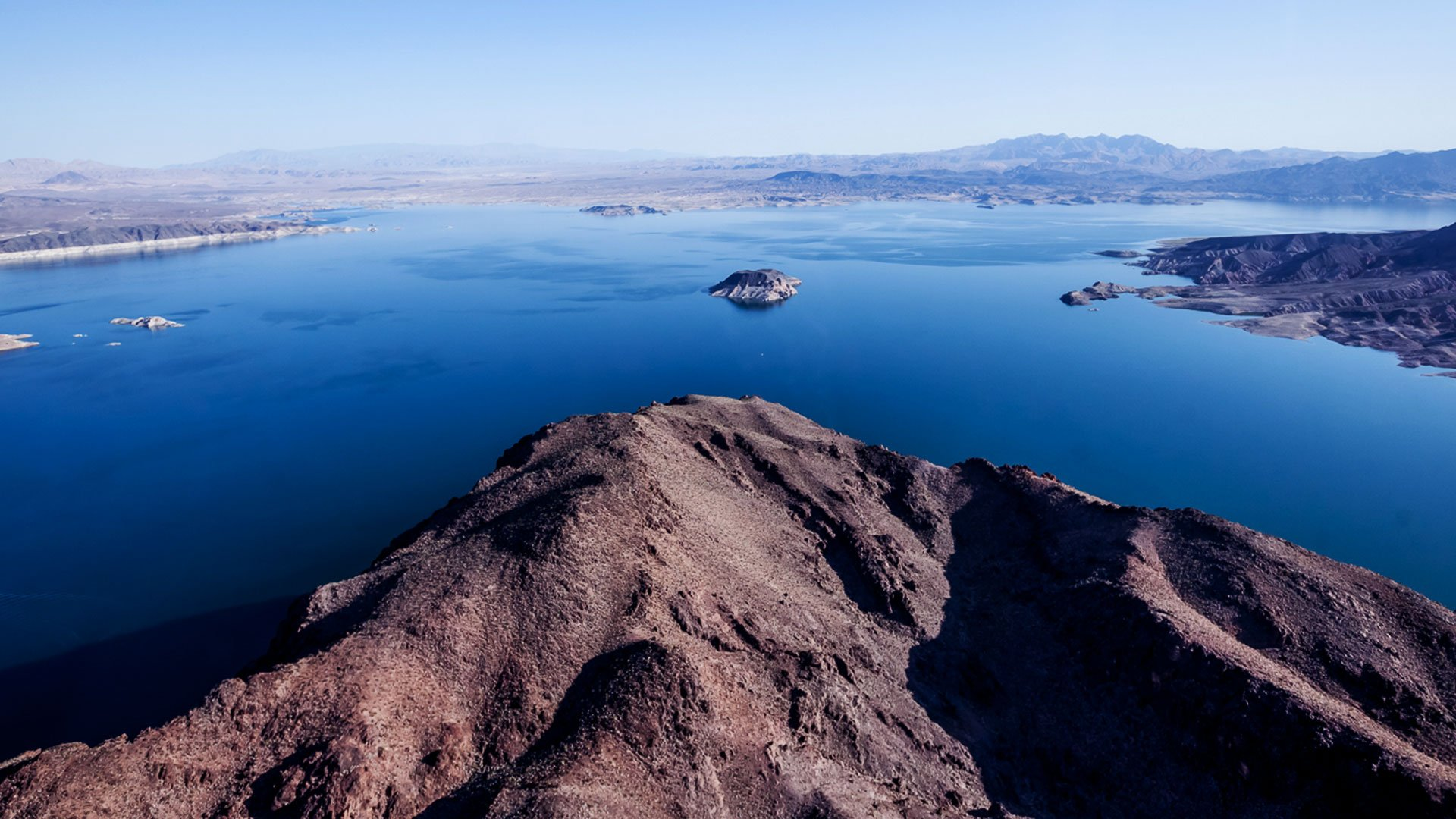 Aerial view of the bright blue waters of Lake Mead. Papillon air tours