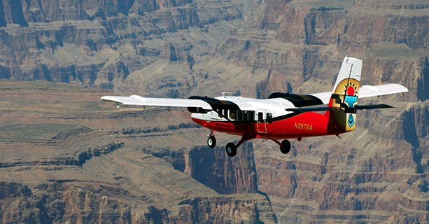 An airplane tour soaring over the Grand Canyon West.