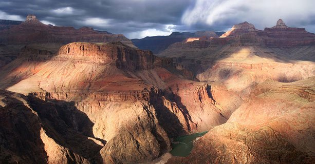 The Grand Canyon National Park lit by partly cloudy skies.