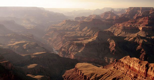 A view of the misty expanse of the Grand Canyon.'