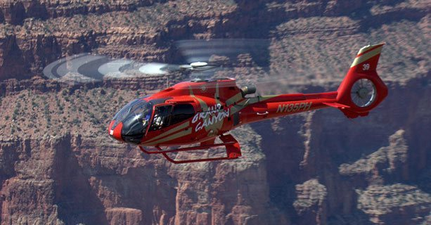 Helicopter in flight over Grand Canyon National Park.