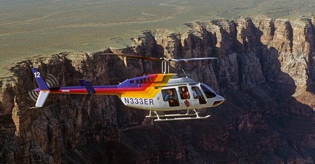 Bell helicopter soaring over the Grand Canyon