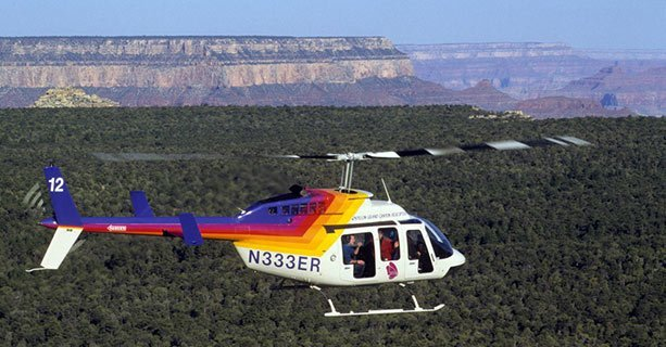 A Bell Helicopter soaring over Grand Canyon National Park